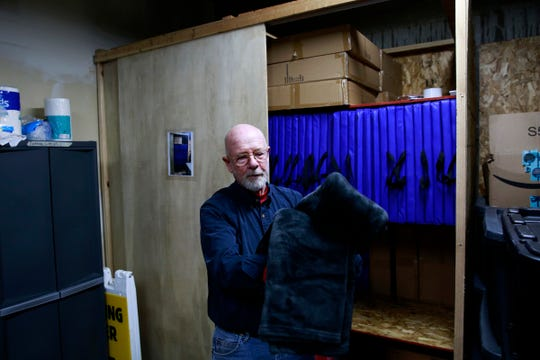 Larry Wood, church member and warming shelter volunteer, displays the blanket that homeless people using the warming shelter receive for the night while staying at Salem First Presbyterian Church in Salem, Oregon on Monday, Oct. 28, 2019.