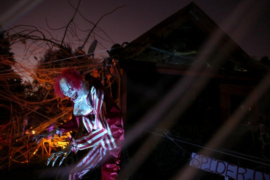 Halloween decorations overtake a house in north Salem on Oct. 24, 2019. Stacey Smith spends two months decorating her already black and orange Salem home for Halloween. She creates a free haunted house experience for kids, complete with candy.