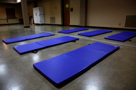 Several mats for use by homeless people lie on the ground in the warming shelter area at Salem First Presbyterian Church in Salem, Oregon on Monday, Oct. 28, 2019.