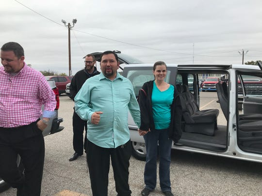 Victor and Elisabeth Gutierrez thank members of All American Chevrolet, 203 N. Bryant, and Joshua 1:2 Fellowship after they received a free van on Monday, Oct. 28, 2019.