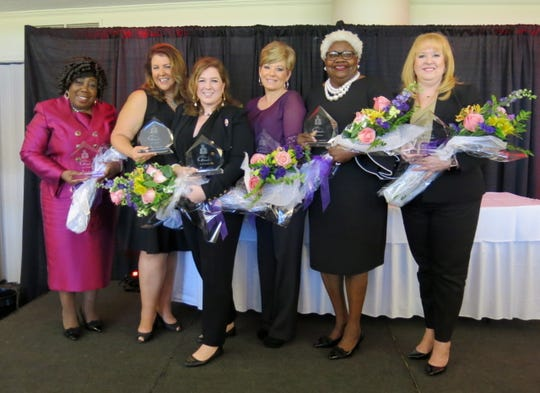The Times Virginia K. Shehee Most Influential Woman finalists: Brenda Giles, standing in for her daughter JoAnne Walker, who at at last minute could not attend; Dr. Andrea M. Everson; The Times 2019 Most Influential Woman recipient K.C. Kilpatrick; and Donna Otwell, Mary Trammel, Laurie McGehee at the luncheon honoring them.