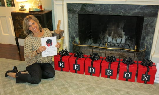 New Feist-Weiller Development Director Krista Gaston showing off gifts for Life Savers 2019 at the Sponsor Party.
