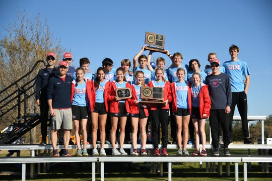 Class AA cross country combined team champion Lincoln Patriots