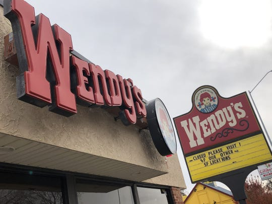 A sign in front of the Sioux Falls Wendy's location at 708 S. Minnesota Ave. says the store is closed.