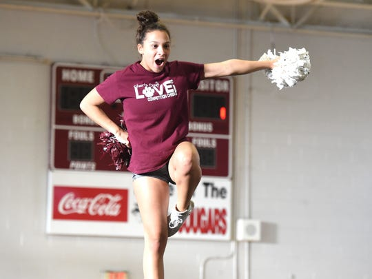 Bethesda Stewart, a Stuarts Draft junior, practices with the competition cheer team as they get ready for the Region 2B competition.