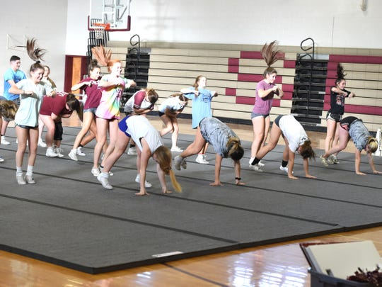 The Stuarts Draft competition cheer team, which won the Shenandoah District tournament, practicing Thursday, Oct. 24 to get ready for the regional tournament.