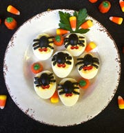 Black olives do the trick in Spooky Spider Deviled Eggs.