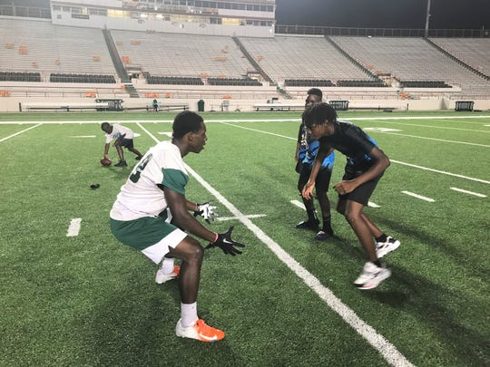 Kemarion Gadson of the Gadsden County Jaguars goes one-on-one versus FAMU wide receiver Xavier Smith. The Jaguars attended FAMU football practice on Sunday, Oct. 27, 2019.