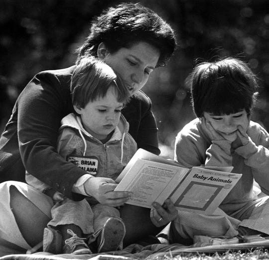 Former Finders member Paula Arico and her children John Paul, 2, and Mary, 7, enjoy the sunshine in the backyard of their apartment.
