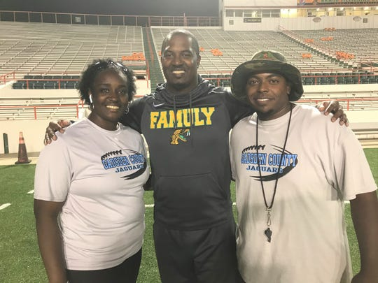 FAMU football head coach Willie Simmons (center) worked with Shawanna Moye and Padryck Beamon to have the Gadsden County Jaguars  attend practice for the Rattlers on Sunday, Oct. 27 at Bragg Memorial Stadium.