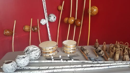 Instruments made of gourd, wood, and wire are used at Tallahassee Capoeira and a seated circle of children, adolescents and adults chant and clap in Portuguese, a language none of them understand.