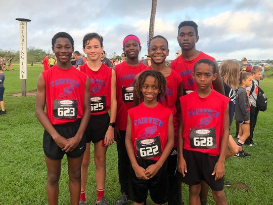 Fairview Falcons runners Patrick Koon, Justin Greenwood, Ranceeson Grace, Joshua Osborne, Enijah Thomas, Keno Rivers and 4th grader, Emari Thomas (Enijah's brother) who ran in place of Rashado Arnold, who qualified but was unable to make the trip.