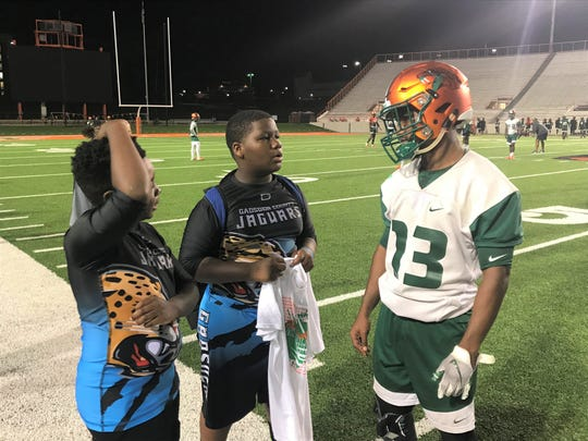 FAMU running back Bishop Bonnett talks with Terrance Williams (center) and Myles Black of the Gadsden County Jaguars during practice on Sunday, Oct. 27 at Bragg Memorial Stadium.