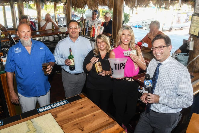 Family Meals Celebrity Bartenders, from left, Brett Mercuio of Sailfish Brewing Co., Brad Gould of Dean Mead Attorneys at Law, Maryann Brancaccio Matteo of Seacoast Bank and Gabby Rothman of the Public Defender's Office, with special guest Jon Shainman of WPTV News Channel 5.