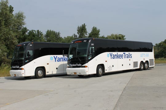 Full-service travel agency Yankee Trails offers its clients free round-trip transfers in its comfortable Cruise Express shuttle.