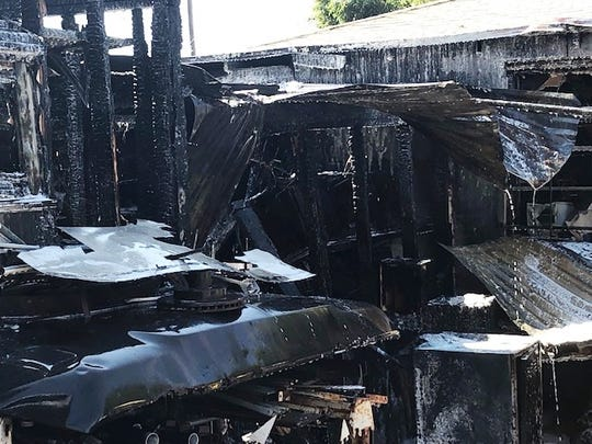 Fire caused heavy damage to sheds outside a house in west Ventura, on Wall Street, Monday.