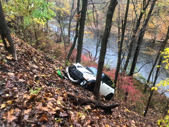 A car is pulled up a hillside after plummeting about 75 feet off Route 129 near the Croton River in Cortlandt on Oct. 27, 2019.