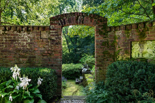 This 1900s colonial boarders 70 acres of a nature preserve's wooded trail on a private lane overlooking the Ardsley Country Club's historic landscape.
