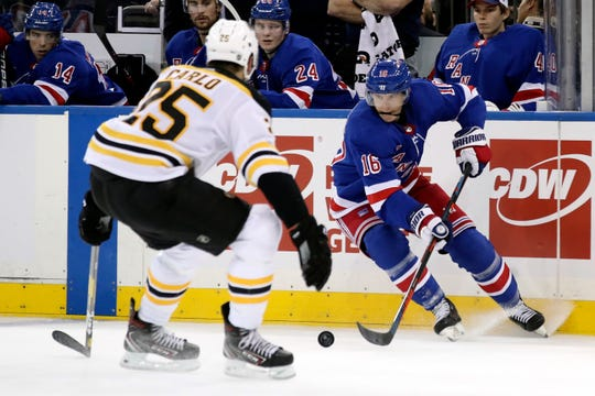 New York Rangers center Ryan Strome (16) skates against Boston Bruins defenseman Brandon Carlo (25) during the second period of an NHL hockey game, Sunday, Oct. 27, 2019, at Madison Square Garden in New York. (AP Photo/Mary Altaffer)