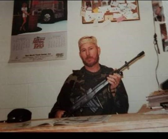 Wichita County sheriff's deputy Ed Daniels served as an undercover agent for the Texas Department of Public Safety during his varied career. Here he is picture holding a machine gun he bought -- but no longer has -- during his time undercover.