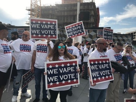 Dozens of vaping advocates made their feelings known outside the American Airlines Center in Dallas during an October 2019 rally for President Donald Trump.