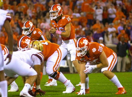 Clemson quarterback Trevor Lawrence waits to receive a snap during the first quarter against Boston College at Clemson Memorial Stadium.