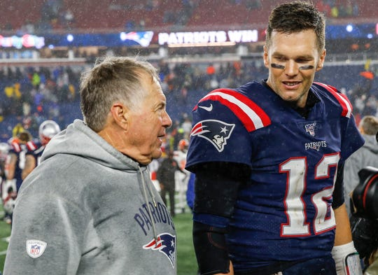 Two major reasons the New England Patriots are the most powerful team in the NFL: head coach Bill Belichick and  quarterback Tom Brady, here after Sunday's win over the Browns.