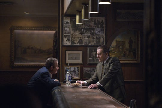 "Russell Bufalino (Joe Pesci, left) is a close confidante and boss to Frank Sheeran (Robert De Niro) in Martin Scorsese's ""The Irishman."""