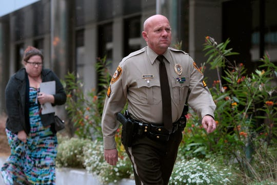 St. Louis County police Sgt. Keith Wildhaber returns from lunch shatter to the St. Louis County courthouse on the third day of his discrimination case in opposition to the county on Thursday, Oct. 24, 2019, in Clayton, Mo.