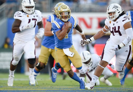 UCLA quarterback Dorian Thompson-Robinson runs the ball during the first half against Arizona State.