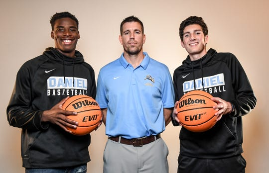 D.W. Daniel High School men's basketball with Brenton Benson, coach Ben Touchberry, and Andrew Latiff.