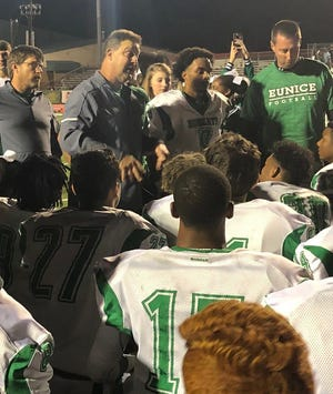 Longtime Eunice football coach Paul Trosclair speaks to his team after the Bobcats defeated Tioga, 32-27, Thursday night. Trosclair, who spent four seasons as Oakdale's head coach in the 1990s, led Eunice to its first state title in 36 seasons last year. It also was his first state championship as a head coach, and came four years after Trosclair was diagnosed with cancer.