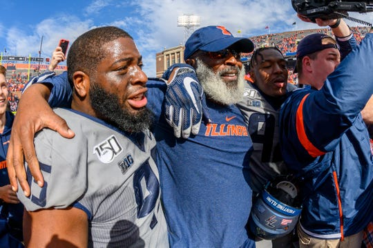 Oct 19, 2019; Champaign, IL, USA; Illinois Fighting Illini head coach Lovie Smith hugs defensive lineman Kenyon Jackson (left) after the second half against the Wisconsin Badgers at Memorial Stadium. Mandatory Credit: Patrick Gorski-USA TODAY Sports
