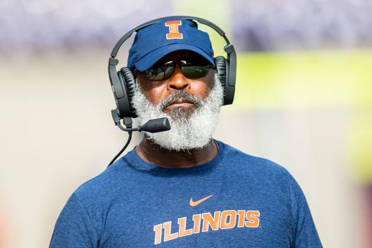 Oct 19, 2019; Champaign, IL, USA; Illinois Fighting Illini head coach Lovie Smith reacts after a touchdown against the Wisconsin Badgers during a game at Memorial Stadium. Mandatory Credit: Patrick Gorski-USA TODAY Sports