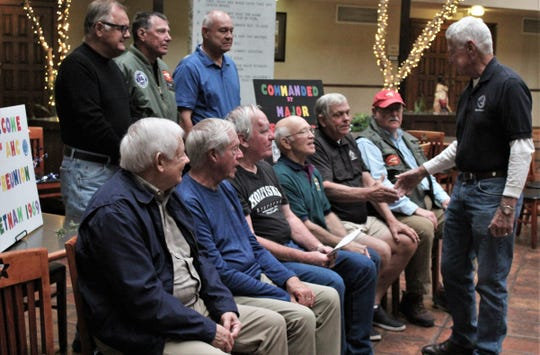 "Lt. Col. (ret). Jeff Goodin, right, shakes hands with each of the nine men who came to Abilene from six states to honor him 50 years after serving in Vietnam. They referred to Goodin then as ""The Old Man"" because he was 31 and most still were in their teens."