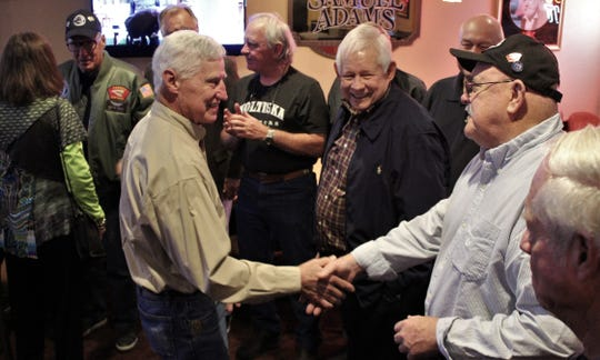 Rich Rich greets his former CO, Maj. Jeff Goodin, with a handshake Monday evening at MCM Elegante, where a 50th reunion of the 174th Assault Helicopter Company. The men fought together in 1969 in Vietnam.