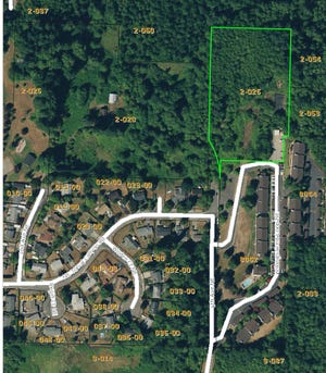 On Monday, Kitsap Housing's Board of Commissioners approved listing the undeveloped 4.11 acre property in Poulsbo for sale.