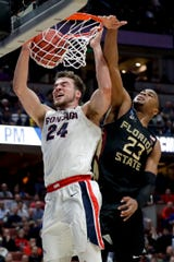Gonzaga forward Corey Kispert dunks past Florida State guard M.J. Walker during the NCAA tournament West Region semifinal. Gonzaga must replace four starters from that team in 2019-20.
