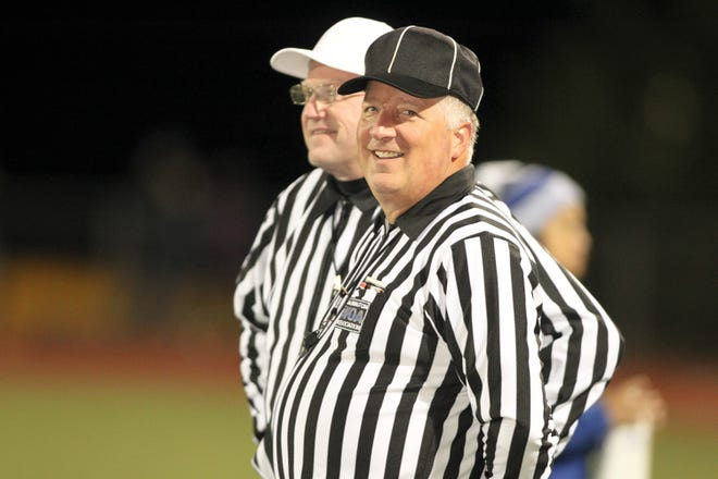 Steve Lingafelter, in black hat, officiating a game with Dave Paul.