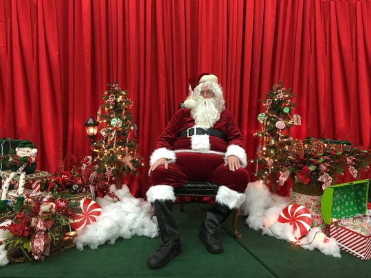 Santa takes a rest before the onslaught of visitors expected at the Giant Christmas Bazaar at Suntree United Methodist Church on Saturday, Nov. 9.