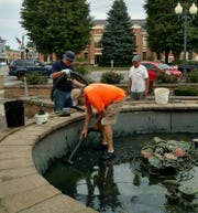 Two board members of the nonprofit organization Projects Inc. president Mike Hoffman and Ken Cameron, along with volunteer Dick Hulsmeyer recently worked to clean and shut down the fountain.