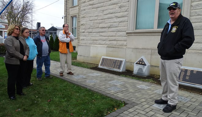 Don Scheerer, right, secretary/treasurer of the Crawford CountyVeterans Hall of Fame, speaks Tuesday during a brief ceremony marking the installation of new plaques honoring county residents killed while serving in the military.