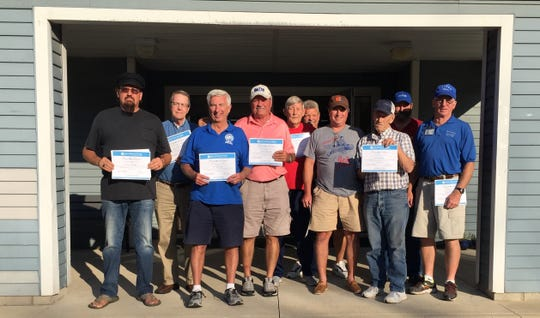 Council on Aging drivers who received a safe driving certificate include Gary Harigle, Kevin Ruth, Darrell Smith, Dave Reffey, Ron Higbie, Don Heydinger, Don Neumann, Jack Starcher, Mike Tighe and Mike Browning. Not pictured, Sam Eichhorn.