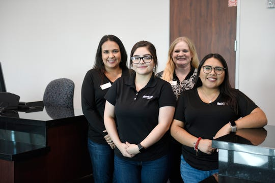 NavyArmy Community Credit Union employees pose for a photo, Tuesday, Oct. 29, 2019. The credit union's Kostoryz location has 15 employees.