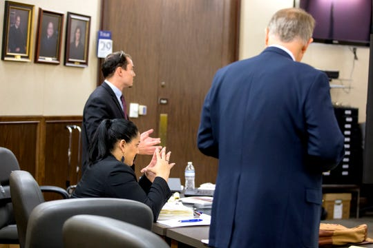 Prosecutors Jared Horton (from left left), Angelica Hernandez and defense attorney Richard Rogers III argue an objection in the capital murder trial of Ismael Castillo, 32 in the 347th district court on Tuesday, October 29, 2019. Castillo is one of three defendants on trial for capital murder in the death of Deandre Mathis, 19.