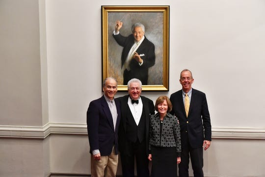 The Valentines with the portrait of Carmen DeLeone at Music Hall. Pictured (from left) are Carl J. Samson, portrait artist; DeLeone, the Cincinnati Ballet's music director; Margaret Valentine; Michael Valentine