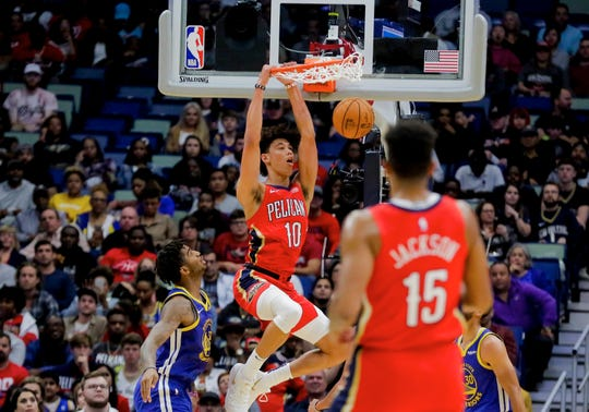 New Orleans Pelicans center Jaxson Hayes (10) dunks against the Golden State Warriors forward Marquese Chriss (32) during the second quarter at the Smoothie King Center on Oct. 28.