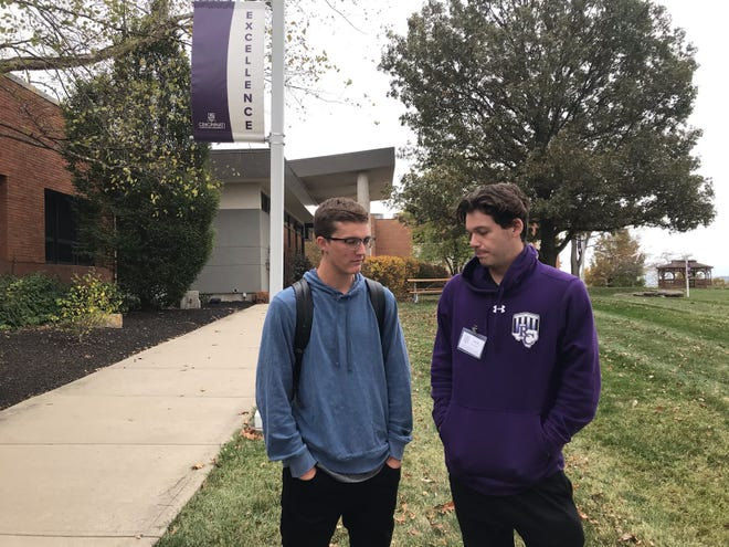 Jack Collins (right) and Evan Meyer chat on Cincinnati Christian's campus one day after the school announced it will close.