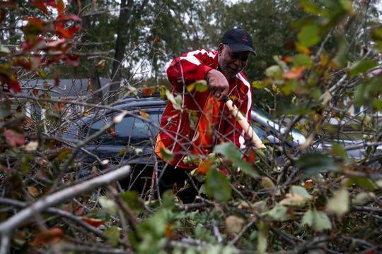 Larry Starnes cuts limbs down to the 6ft and under limit requested by city officials for debris to be taken off of yards after the storm on King Cole Drive in Clarksville, Tenn., on Monday, Oct. 28, 2019.