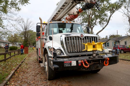 Line maintenance crews from Huntsville work on power lines and clearing yards on Storybook Drive in Clarksville, Tenn., on Monday, Oct. 28, 2019.